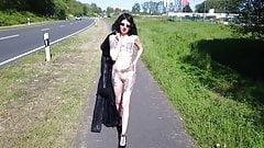 Shameless slut walks nude on a public road
