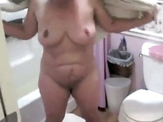 Nude female hot tub party - Mature nude female ss drying off after bath non-sexual