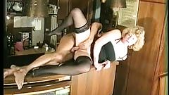 Barmaid has fun with a client - vintage