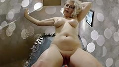 Slim woman with glasses masturbates on camera