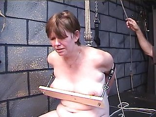 Fat woman fetish - Fat woman gets her boobs nailed in wood in dungeon play with older master