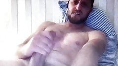 Bearded muscle guy edging his huge cock