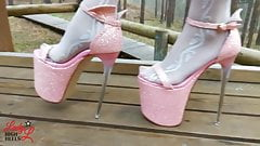 Lady L walking in tower pink extreme high heels.