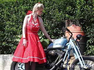 Blond bike fuck Cute blonde enjoys posing next to a bike