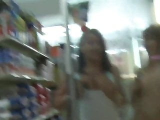 Naked girls showing off Three girls showing off their naked bodies in a supermarket