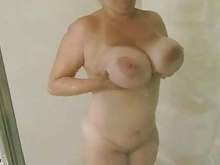 Monster milf boobs Huge natural boob milf rubbing monster tits on the glass