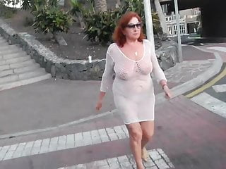 Naked boobs on chicks Beautiful mature slut walks around the city with naked boobs