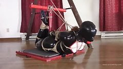 Burglar in latex tightly bound and gagged