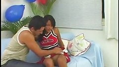 Latina cheerleader takes boyfriend's huge cock on a couch