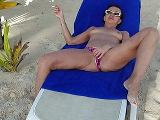 Strip for a woman Vacation 2019. hot milf is playing and stripping on a beach