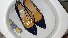 Pissing into Dark Blue Stilettos bought from a bank employee