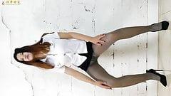 Asian girl dance in pantyhose miniskirt and heels 2