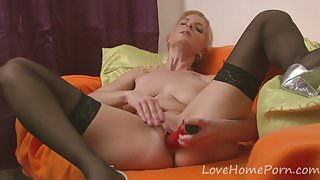 Blonde in stockings enjoys her new toy