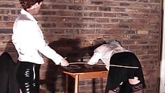 Mistress E canes a student