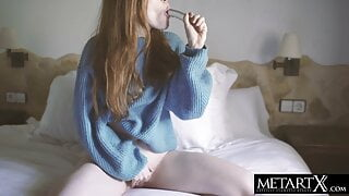 Redhead fucks her pussy to an orgasm with a big glass dildo
