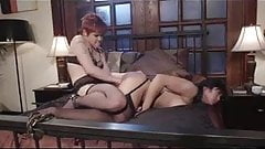The Redhead Lesbian Femdom has fun with her Asian Pet