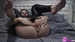 Brunette with leather tights masturbates