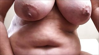 Granny with soaking wet cunt shaking her tits and fat belly