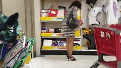 Sexy ebony shopping after work in dress