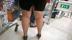 Chubby MILF sexy legs and heels waiting line