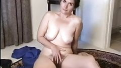 Mature woman shows off curvy body and her beautiful hairy pussy
