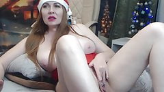 Redhead woman in Christmas cap jerks off on camera