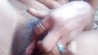 Finger goes to her wet pussy
