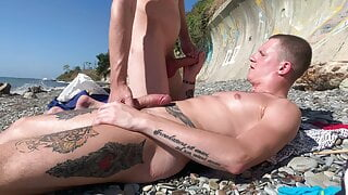 Jerk off and sucked a buddy on the beach