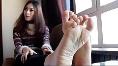 feet by the window