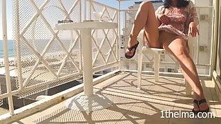 hidden camera caught a sexy girl masturbate on the hotel balcony