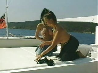 Busty women clips - Busty women with fake tits and heavy piercing on boat