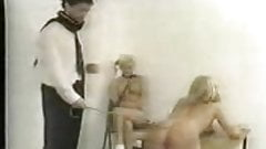 Blonde Teen gets caned bent over a table