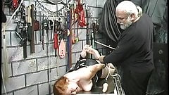 Red head slave is bound to table and fucked by dildo