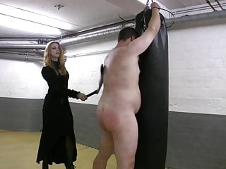 Femdom videos whips Very hot redhead mistress in leather whipping tied up slave