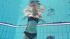 Redheaded Katrin is stripping underwater